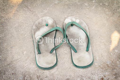 old white - green plastic sandals : Stock Photo