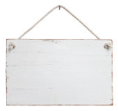 Old weathered white wood signboard.