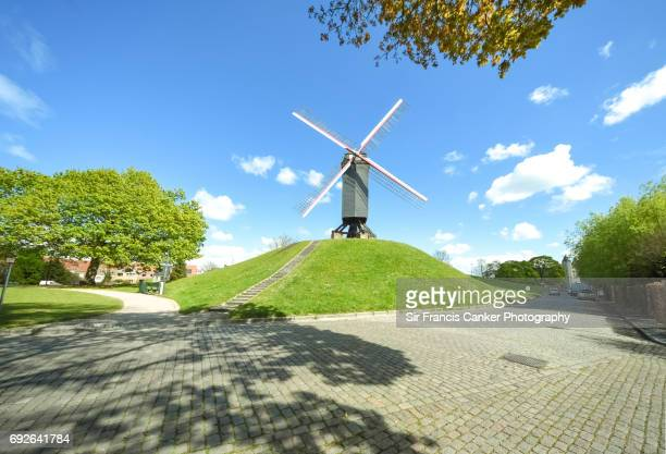 Old windmill on top of a green hill in downtown Bruges, Flanders, Belgium