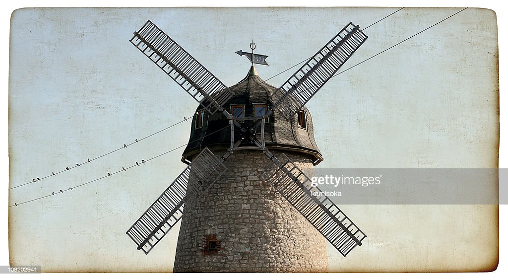 Old windmill on vintage paper : Stock Photo