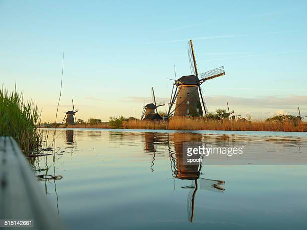 Old windmills near canal in Netherlands