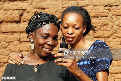 Old woman and her daughter with a mobile phone