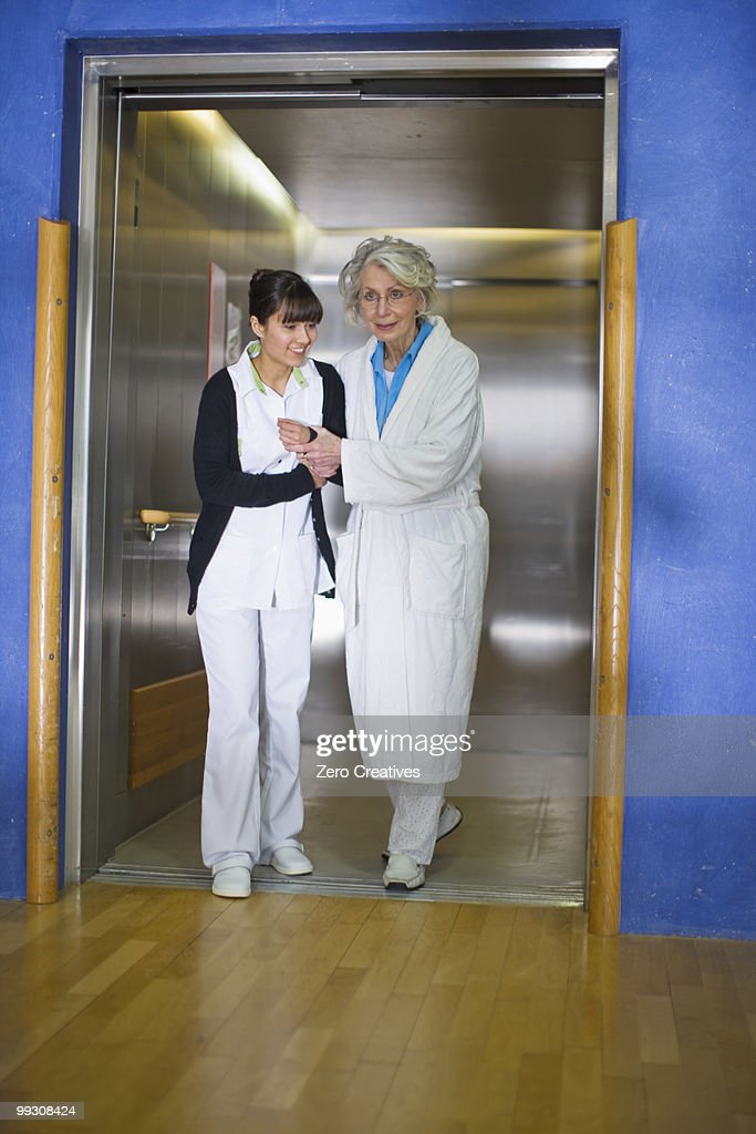 Old woman and nurse : Stock Photo
