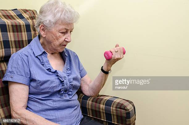 Old woman doing wrist exercise