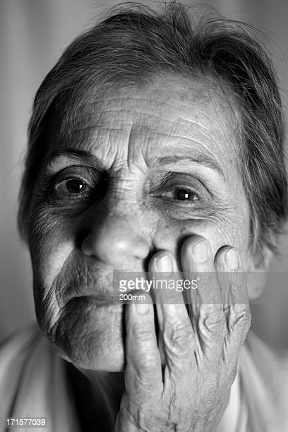 Old Woman Hand on Face