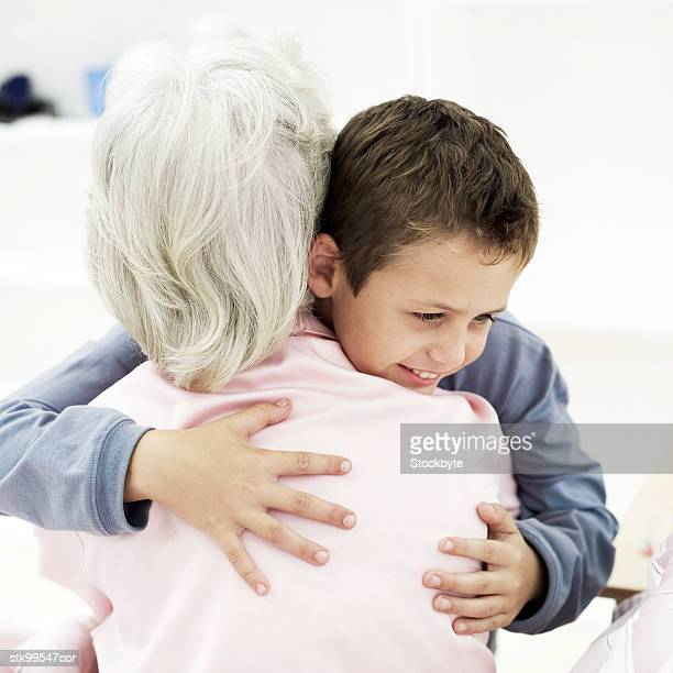 old woman hugging a boy (6-8)
