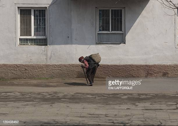 Old woman in Pyongyang North Korea on April 14 2008