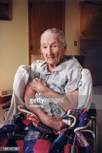 old woman in wheel chair in nursing home