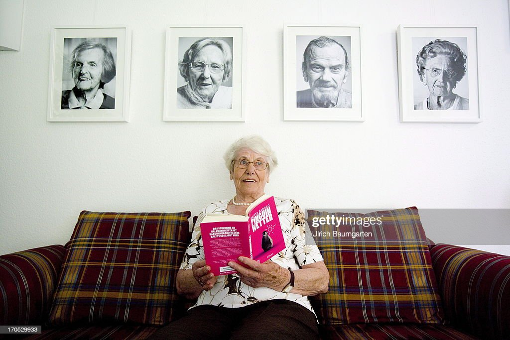 Old woman reading a book in the retirement home Haus Salem on May 14, 2013 in Ratingen, Germany.