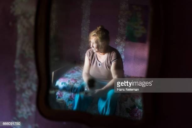 Old woman reflected in the mirror