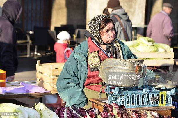 Old woman sell her vegetables at traditional Dolac Market in the city center of Zagreb Croatia on 31 December 2016