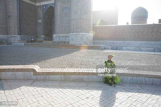 Old woman sitting on the square, Samarkand