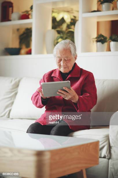 Old Woman Using tablet PC