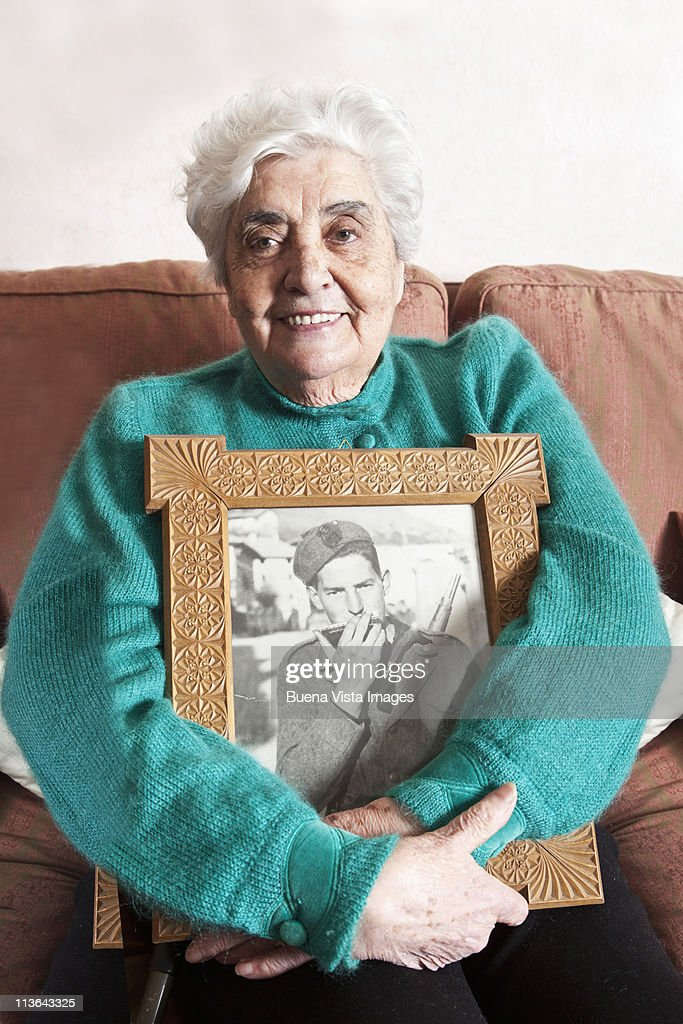 Old woman with picture of her late husband : Stock Photo