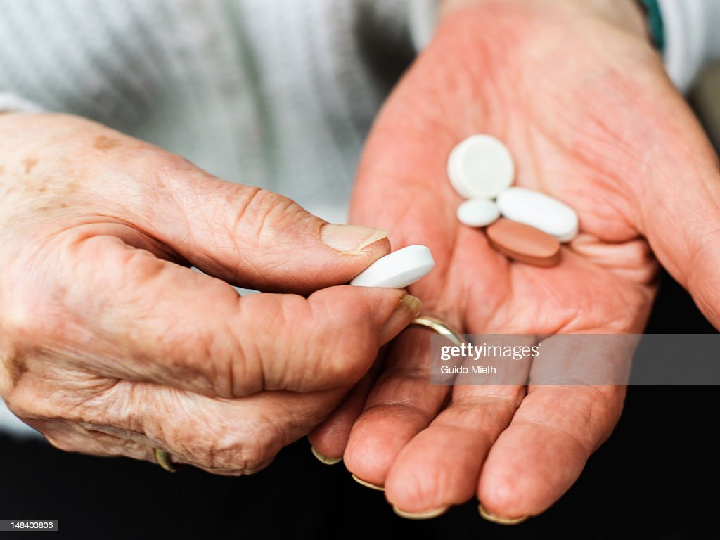 Old woman with pills : Stock Photo