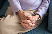 Old woman�s hands in lap