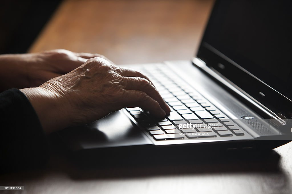 Old women typing : Stock Photo