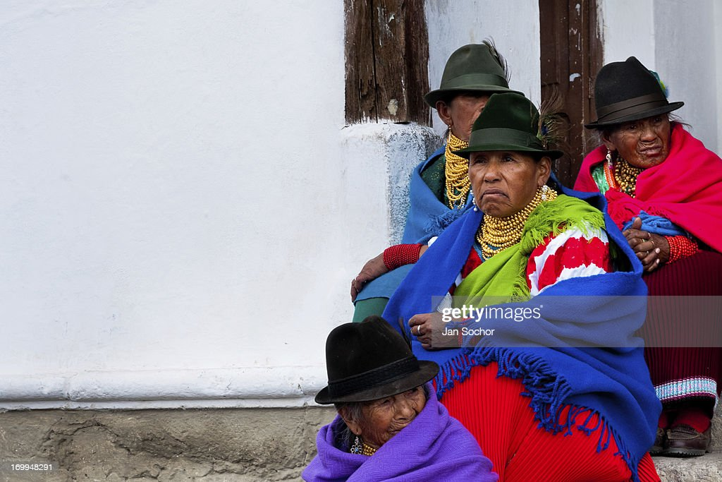 "Old women, wearing colorful clothes, watch a procession during the Inti Raymi festival in the village of Pesillo, Ecuador, 26 June 2010. Inti Raymi, ""Festival of the Sun"" in Quechua language, is an ancient spiritual ceremony held in the Indian regions of the Andes, mainly in Ecuador and Peru. The lively celebration, set by the winter solstice, goes on for various days. The highland Indians, wearing beautiful costumes, dance, drink and sing with no rest. Colorful processions in honor of the God Inti (Sun) pass through the mountain villages giving thanks for the harvest and expressing their deep relation to the Mother Earth (Pachamama)."