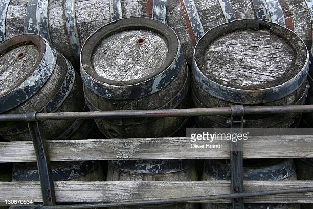 Old wooden beer kegs on a cart