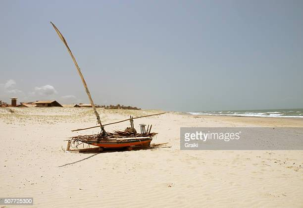 Old wooden boat abandoned on the beach.