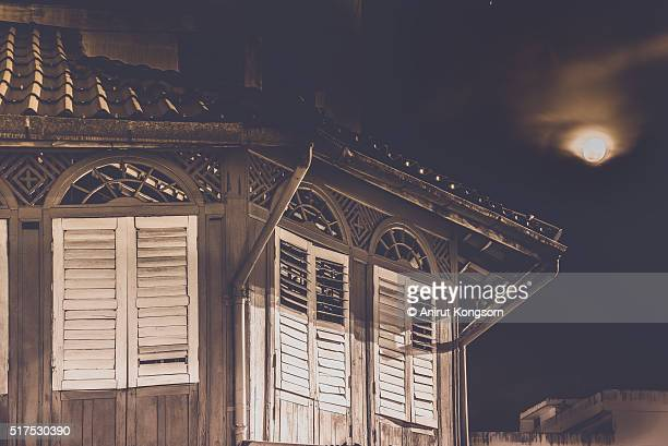Old wooden  Building and The moon.