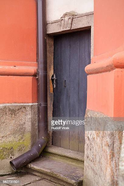 Old wooden church door (backdoor), rain gutter
