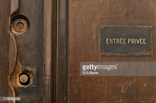 Old wooden door with two locks