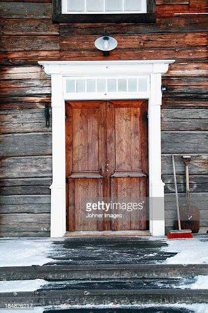 Old wooden house in winter