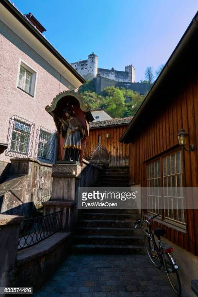 Old wooden houses and the fortress Hohensalzburg castle in the historic center on April 19 2015 in Salzburg Austria