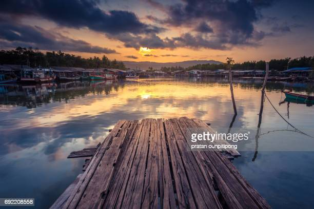 Old wooden pier above water