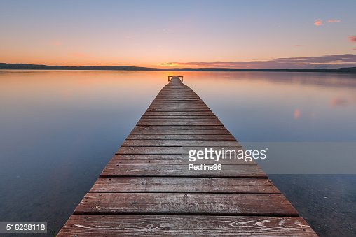 Old wooden pier on sunset : Stock Photo