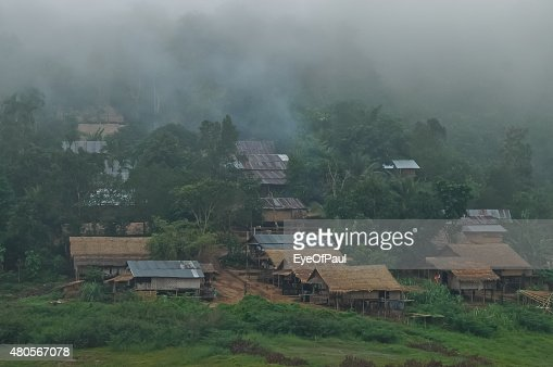Old wooden small village in misty foggy morning in Sangkhalaburi : Stock Photo