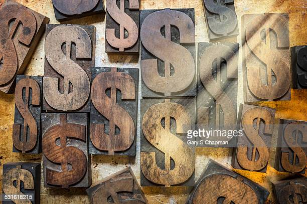 Old wooden type with dollar signs