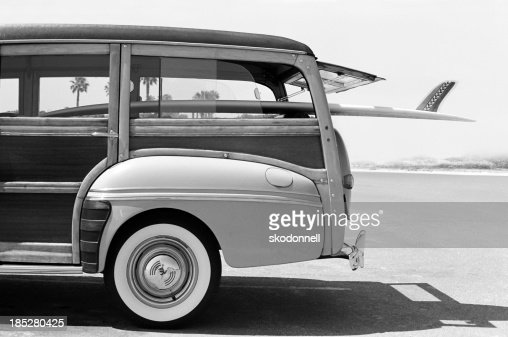 Old Woodie Station Wagon with Surfboard