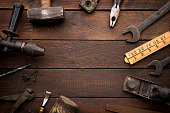 Old Work Tools on Rustic Background with copy space