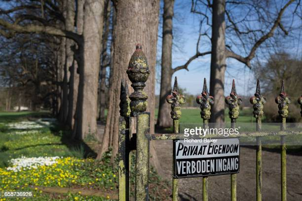 Old wrought iron gates and no entry sign at the entrance of the privatelyowned de Merode Castle out of bounds for locals on 25th March in Everberg...