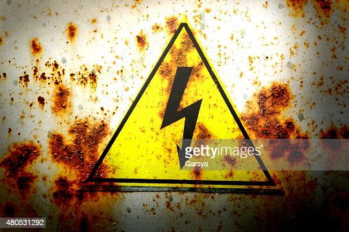 Old yellow high voltage sign : Stock Photo