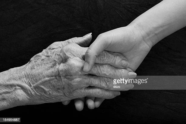old young hands reaching and holding