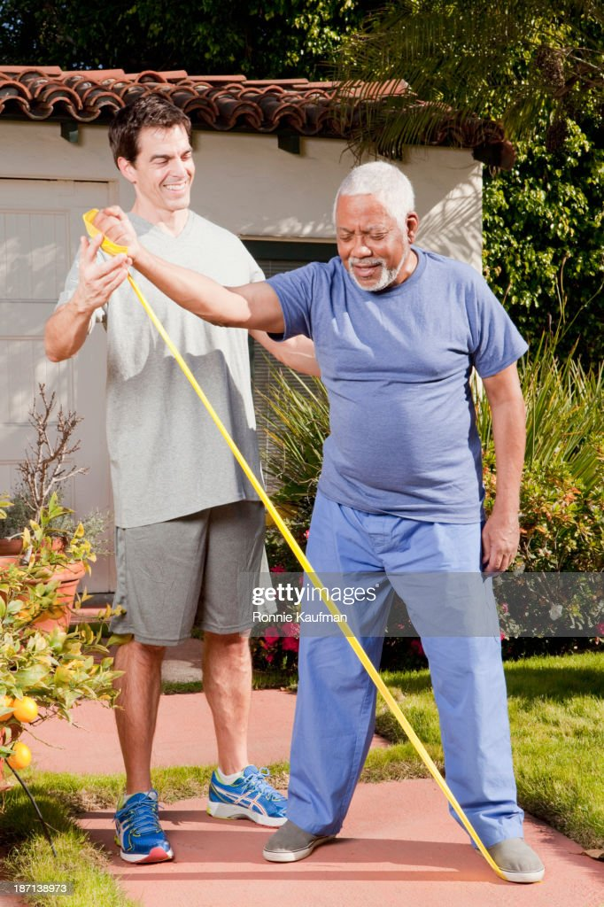 Older African American man working with trainer