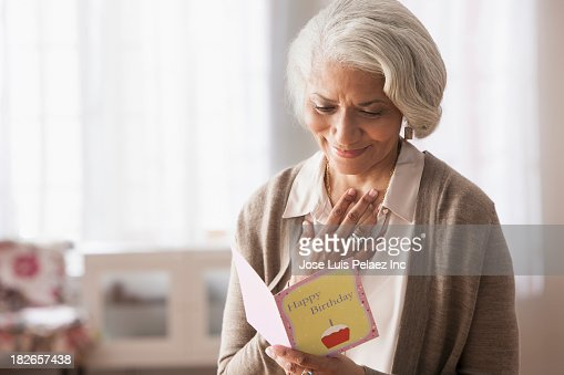Older African American woman reading birthday card