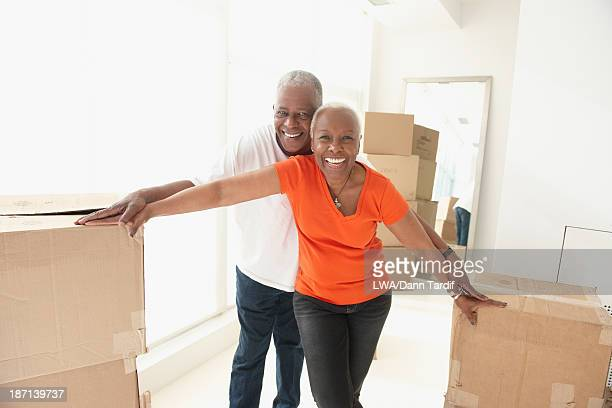 Older Black couple smiling in new home
