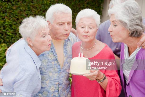 Older Caucasian friends celebrating birthday