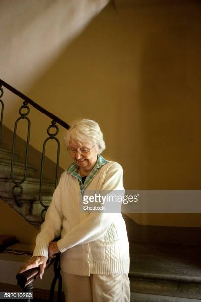 Older Caucasian woman climbing stairs