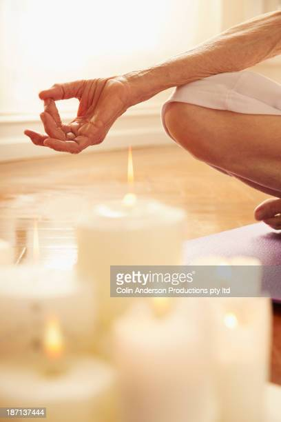 Older Caucasian woman meditating