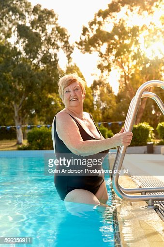 Older Caucasian Woman Smiling In Swimming Pool Stock Photo Getty Images
