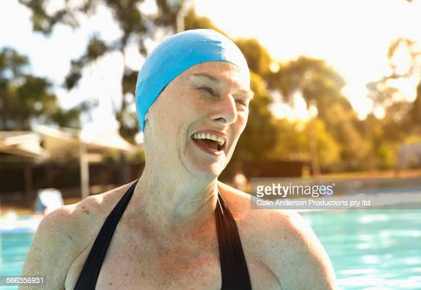 Older Caucasian woman wearing swimming cap in pool