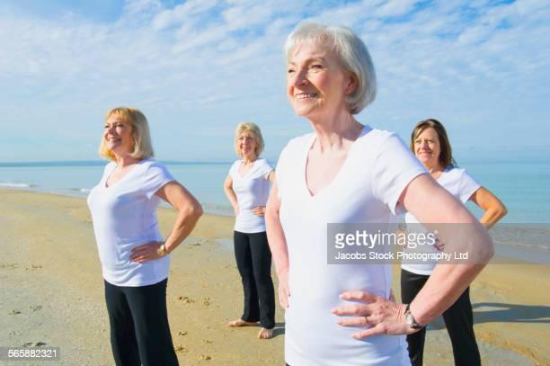 Older Caucasian women standing on beach