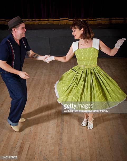 Older couple dancing in auditorium