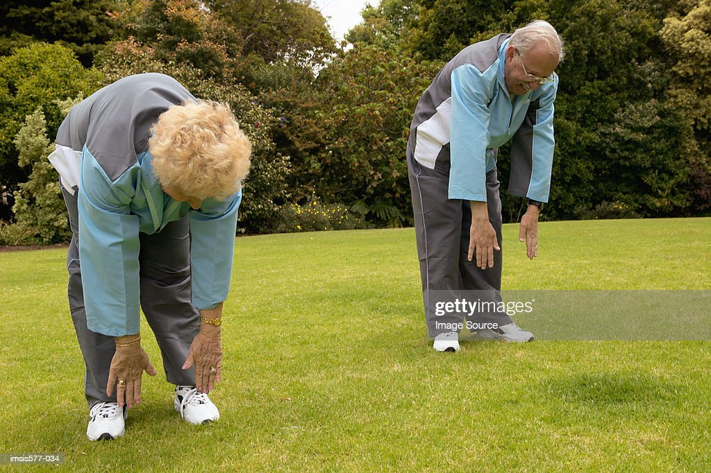 Older couple exercise outdoors : Stock Photo