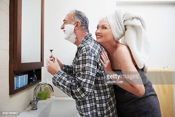 Older couple getting ready in bathroom